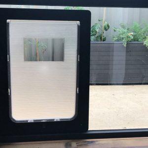 Custom made dog door